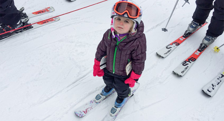child unhappy skiing